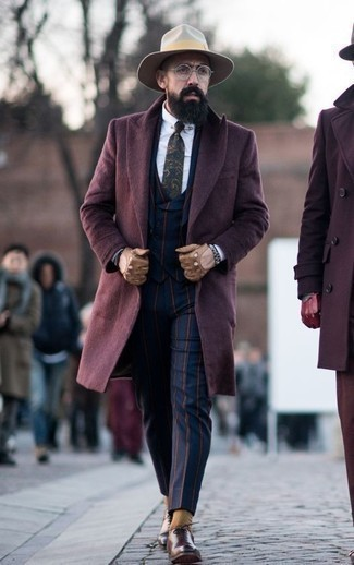 How to Wear a Navy Paisley Tie For Men: Teaming a burgundy overcoat and a navy paisley tie is a surefire way to infuse masculine refinement into your styling repertoire. All you need is a pair of brown leather oxford shoes.