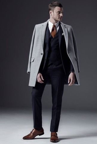 How to Wear a Grey Overcoat: Team a grey overcoat with a navy three piece suit if you're aiming for a clean-cut, stylish ensemble. Brown leather double monks will add a more casual aesthetic to an otherwise dressy ensemble.