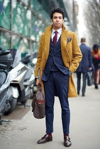 How to Wear a Burgundy Polka Dot Tie For Men: Pairing a mustard overcoat and a burgundy polka dot tie is a surefire way to infuse your closet with some manly sophistication. Take an otherwise standard getup down a more relaxed path by rounding off with dark brown leather double monks.