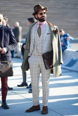 How to Wear a Dark Brown Leather Zip Pouch For Men: A mint check overcoat and a dark brown leather zip pouch married together are a sartorial dream for those who appreciate laid-back styles. Introduce a pair of dark brown suede double monks to the mix to instantly jazz up the look.