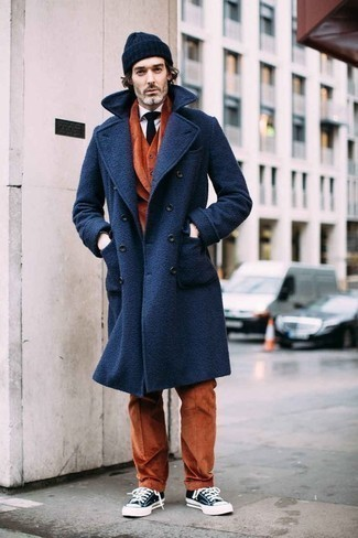 Navy and White Canvas Low Top Sneakers Outfits For Men: A navy overcoat and a tobacco three piece suit are a truly sharp getup to try. Rounding off with a pair of navy and white canvas low top sneakers is an effortless way to add a dose of stylish nonchalance to your outfit.