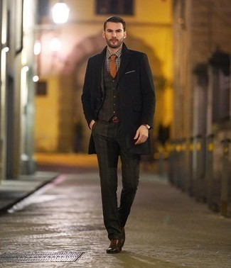 Brown Leather Brogues Outfits: You're looking at the definitive proof that a black overcoat and a dark brown plaid three piece suit look amazing when teamed together in a classy look for today's guy. A pair of brown leather brogues will add a new flavor to an otherwise all-too-safe look.