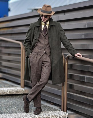 Dark Brown Three Piece Suit with Hat Outfits: This casual combination of a dark brown three piece suit and a hat is a goofproof option when you need to look stylish but have zero time to assemble an outfit. If you want to feel a bit more refined now, complete your look with dark brown suede derby shoes.