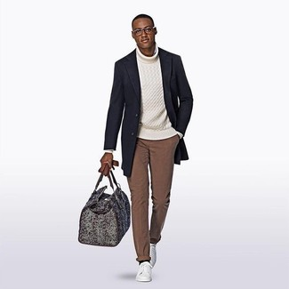 How to wear: navy overcoat, white knit turtleneck, brown chinos, white leather low top sneakers