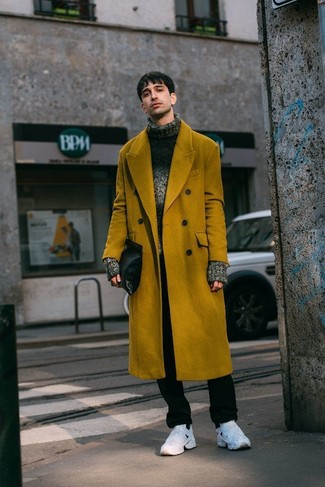 How to wear: mustard overcoat, charcoal knit wool turtleneck, black chinos, white athletic shoes