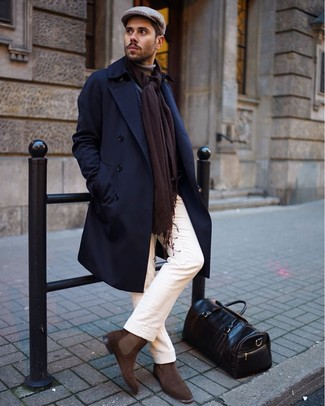 How to wear: navy overcoat, tan turtleneck, white chinos, brown suede chelsea boots
