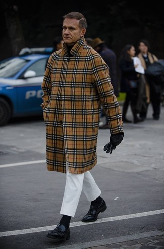 How to wear: camel plaid overcoat, black turtleneck, white chinos, black leather loafers