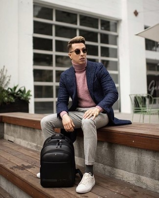 How to Wear a Pink Turtleneck For Men: A pink turtleneck and beige chinos make for the ultimate casual look for any modern gentleman. White canvas low top sneakers are a guaranteed way to give a touch of stylish effortlessness to this ensemble.