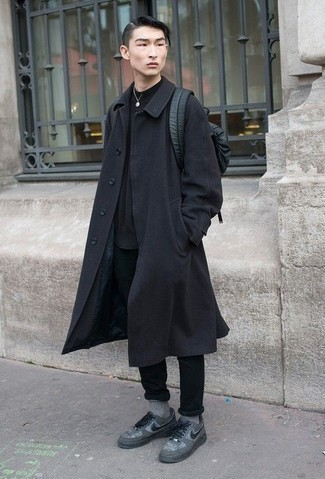 How to Wear a Black Leather Backpack For Men: If you're a fan of modern casual combinations, then you'll like this pairing of a black overcoat and a black leather backpack. Our favorite of an endless number of ways to finish this look is a pair of grey canvas low top sneakers.