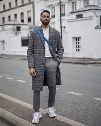 How to Wear Chinos: This combination of a grey plaid overcoat and chinos epitomizes manly elegance and refined functionality. A pair of grey athletic shoes can effortlessly tone down a dressy getup.