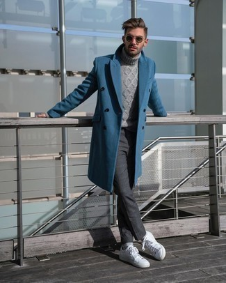 Blue Overcoat Outfits: A blue overcoat and charcoal chinos married together are a perfect match. Introduce a pair of white leather low top sneakers to the mix to instantly rev up the fashion factor of your look.