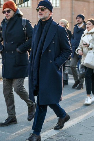 Navy Overcoat Outfits After 50: This classic and casual combo of a navy overcoat and navy corduroy chinos is very easy to put together without a second thought, helping you look awesome and ready for anything without spending a ton of time digging through your wardrobe. Go the extra mile and spice up your look by slipping into a pair of dark brown leather brogues. A good illustration for any gentleman who's still figuring out how to dress age-appropriately.