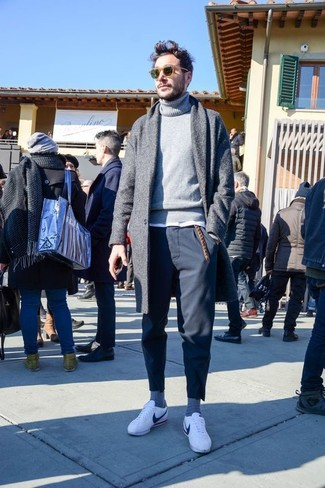 How to Wear a Grey Wool Turtleneck For Men: A grey wool turtleneck and navy chinos will add extra style to your current casual repertoire. White low top sneakers are an effective way to give a dose of stylish nonchalance to this ensemble.