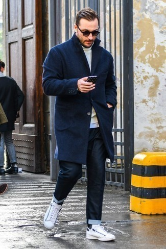 How to Wear Navy Jeans For Men: When it comes to laid-back refinement, this pairing of a navy overcoat and navy jeans never disappoints. You could perhaps get a bit experimental with footwear and play down your outfit by rounding off with white leather low top sneakers.
