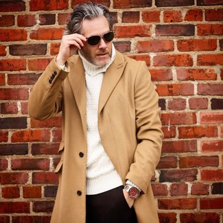 How to wear: camel overcoat, white knit turtleneck, black dress pants, black sunglasses
