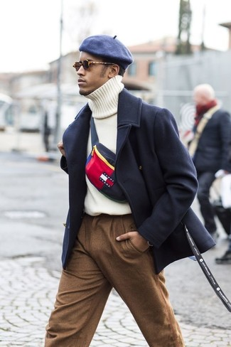 How to wear: navy overcoat, white knit turtleneck, brown wool dress pants, navy flat cap