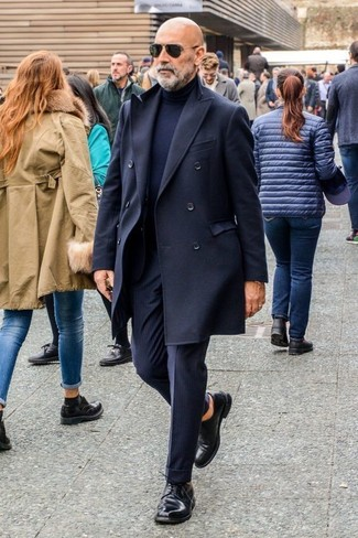 How to wear: black overcoat, navy turtleneck, navy vertical striped dress pants, black leather derby shoes