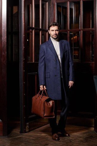 How to Wear a Brown Leather Holdall In Your 30s In Fall For Men: A navy overcoat and a brown leather holdall are a great getup to have in your off-duty wardrobe. Finishing with brown leather tassel loafers is a surefire way to give a sense of refinement to this look. This combination is a pretty great choice, especially for autumn, when the temperatures are falling.