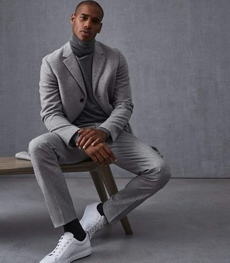 Grey Turtleneck Outfits For Men: Pairing a grey turtleneck with grey dress pants is an awesome idea for a classic and refined outfit. Introduce white canvas low top sneakers to the mix to effortlessly boost the street cred of this outfit.
