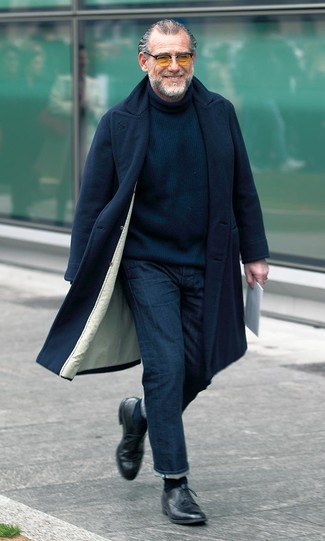 Something as simple as teaming a black overcoat with navy jeans can potentially set you apart from the crowd. Take a classic approach with the footwear and throw in a pair of black leather derby shoes. This look is an exciting choice when it comes to a cool look that will take you from summer to fall.