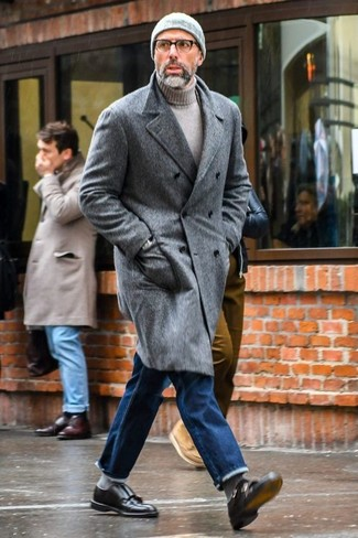 How to wear: grey overcoat, grey turtleneck, blue jeans, black leather double monks