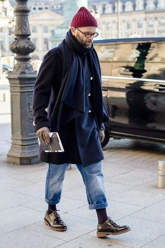 How to wear: navy overcoat, black turtleneck, blue jeans, black leather derby shoes