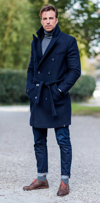 How to wear: navy overcoat, grey turtleneck, navy jeans, brown leather derby shoes