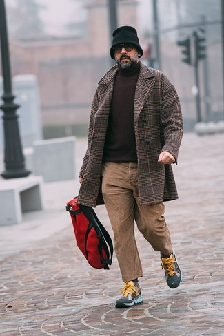 How to Wear Khaki Jeans For Men: This pairing of a dark brown plaid overcoat and khaki jeans crosses the divide between elegant and relaxed casual. Multi colored athletic shoes are the most effective way to infuse a sense of stylish effortlessness into your outfit.
