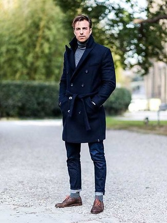 How to Wear a Grey Turtleneck For Men: You'll be surprised at how easy it is for any guy to get dressed this way. Just a grey turtleneck worn with navy jeans. To give this look a sleeker vibe, complement your outfit with a pair of brown leather derby shoes.