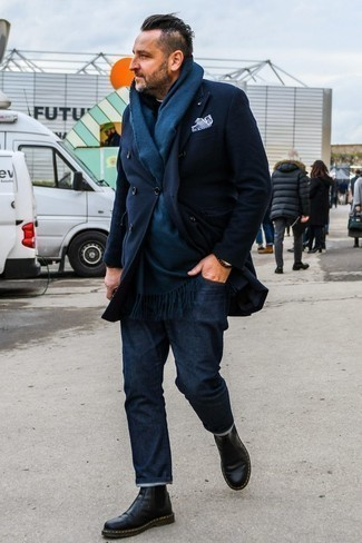 How To Wear Blue Jeans With Black Leather Boots For Men: This combination of a navy overcoat and blue jeans crosses the divide between classic and laid-back. A pair of black leather boots will pull your whole ensemble together.