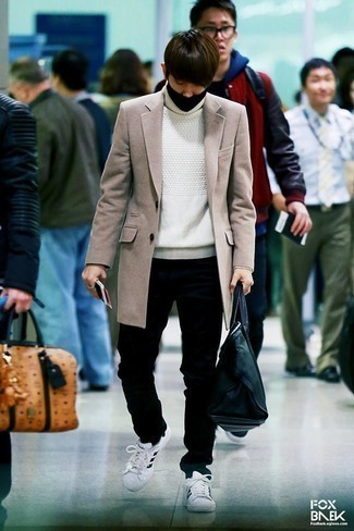 How to Wear Black Jeans In Warm Weather For Men: This combination of a beige overcoat and black jeans is proof that a straightforward ensemble can still be really interesting. Complement your outfit with white and black leather low top sneakers to effortlesslly up the wow factor of your ensemble.