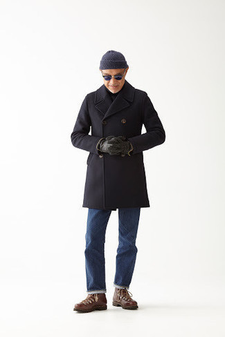 How to Wear Brown Leather Work Boots For Men: A black overcoat and blue jeans are good for both semi-casual events and casual wear. Play down the dressiness of your ensemble by rocking a pair of brown leather work boots.