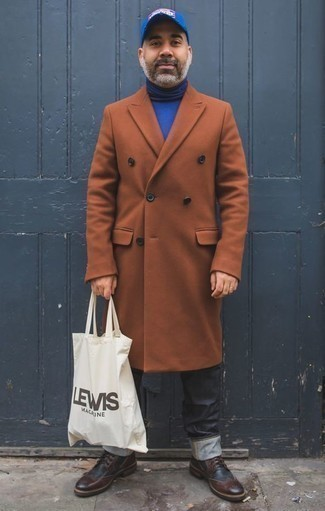 How to Wear a White and Black Print Canvas Tote Bag For Men: Opt for comfort by wearing a tobacco overcoat and a white and black print canvas tote bag. To give your overall ensemble a dressier touch, why not grab a pair of burgundy leather brogue boots?