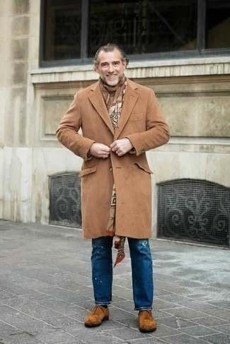 How to Wear Dark Brown Suede Oxford Shoes After 50: You'll be surprised at how very easy it is for any gent to get dressed this way. Just a camel overcoat and blue ripped jeans. Balance this look with a more elegant kind of shoes, like this pair of dark brown suede oxford shoes.