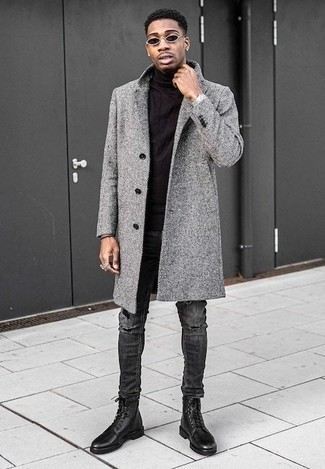 How to Wear a Coat For Men: A coat and charcoal ripped jeans are great menswear pieces to have in the casual part of your wardrobe. To add a bit of zing to your ensemble, complete your ensemble with black leather casual boots.