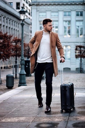 Blue Suitcase Outfits For Men: For a modern casual getup, Pair a camel overcoat with a blue suitcase. Turn up the formality of this getup a bit by finishing off with a pair of burgundy leather chelsea boots.