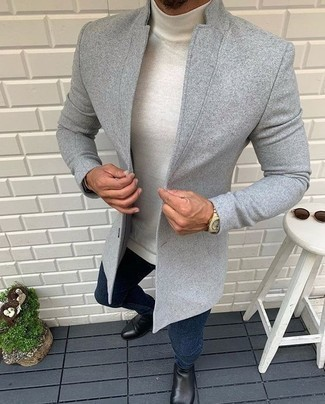 White Wool Turtleneck Outfits For Men: Reach for a white wool turtleneck and navy jeans if you seek to look laid-back and cool without making too much effort. Avoid looking too casual by rounding off with a pair of black leather chelsea boots.