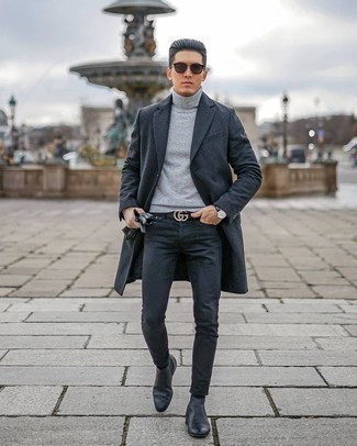 Black Jeans Chill Weather Outfits For Men: This combo of a charcoal overcoat and black jeans looks elegant, but in a modern way. Complete your ensemble with black leather chelsea boots to instantly spice up the outfit.
