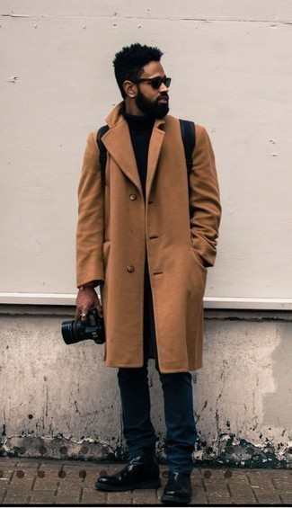 Navy Canvas Backpack Outfits For Men: Beyond dapper and comfortable, this combination of a tobacco overcoat and a navy canvas backpack provides variety. And if you need to instantly up your ensemble with a pair of shoes, introduce black leather chelsea boots to this ensemble.