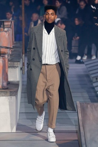 A black and white check overcoat and a black leather belt is a greatcombo for you to try. Add a sportier vibe to your look with white leather slip-on sneakers. When it comes to dressing for autumn, nothing beats a killer combo that will keep you warm and looking your best.