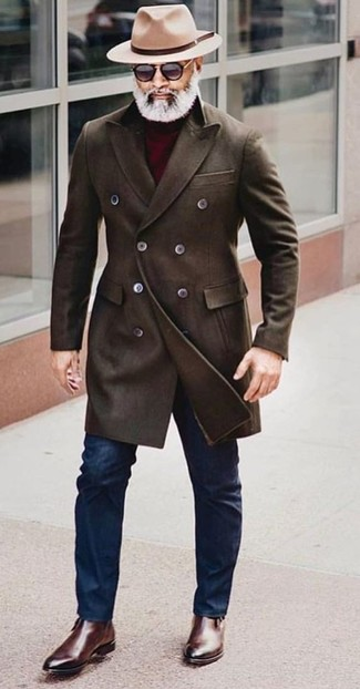 How to wear: dark brown overcoat, burgundy turtleneck, navy skinny jeans, dark brown leather chelsea boots