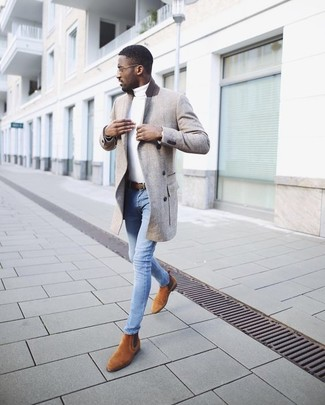 How to wear: grey overcoat, white turtleneck, light blue skinny jeans, tobacco suede chelsea boots