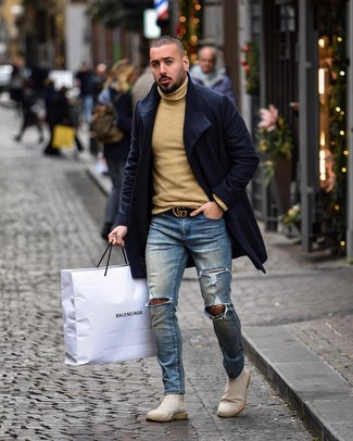 How to Wear Beige Suede Chelsea Boots For Men: Make a navy overcoat and blue ripped skinny jeans your outfit choice to put together a really dapper and modern-looking casual outfit. Beige suede chelsea boots will immediately elevate even your most comfortable clothes.