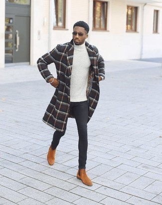 How to Wear Boots For Men: Fashionable and comfortable, this casual combo of a navy plaid overcoat and black skinny jeans delivers variety. Go ahead and complement this getup with boots for an added dose of class.