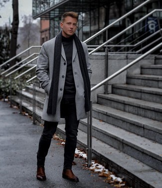 Brown Leather Chelsea Boots Outfits For Men: Marrying a grey overcoat with black skinny jeans is an on-point option for a cool and relaxed look. Feeling transgressive today? Change up your ensemble by rocking brown leather chelsea boots.