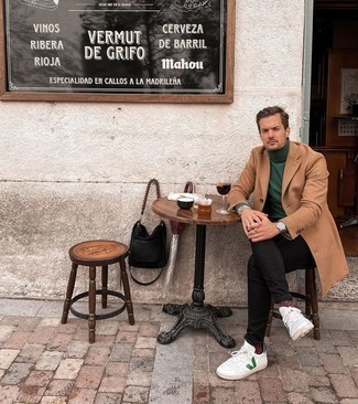 Black Skinny Jeans Outfits For Men: For an ensemble that's very easy but can be modified in a ton of different ways, reach for a camel overcoat and black skinny jeans. Take your look down a more relaxed path with a pair of white and green leather low top sneakers.