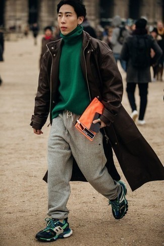 Green Turtleneck Outfits For Men: Flaunt your prowess in menswear styling by combining a green turtleneck and grey sweatpants for a laid-back outfit. Take the casual route in the footwear department by sporting multi colored athletic shoes.