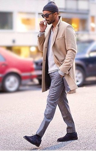 Nail that dapper look with a grey v-neck pullover and grey trousers. Black suede derby shoes will add a new dimension to an otherwise classic look.