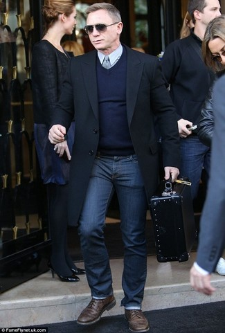 How to wear: black overcoat, navy v-neck sweater, grey dress shirt, navy jeans