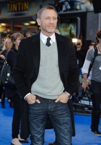 Daniel Craig wearing Black Overcoat, Grey V-neck Sweater, White Dress Shirt, Navy Jeans